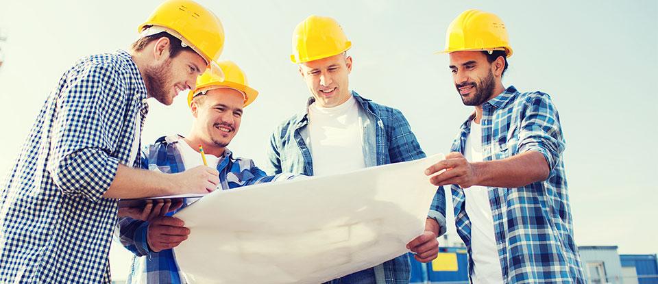 Builders Looking at Design Plan