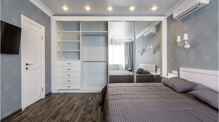 bedroom with wardrobe wall