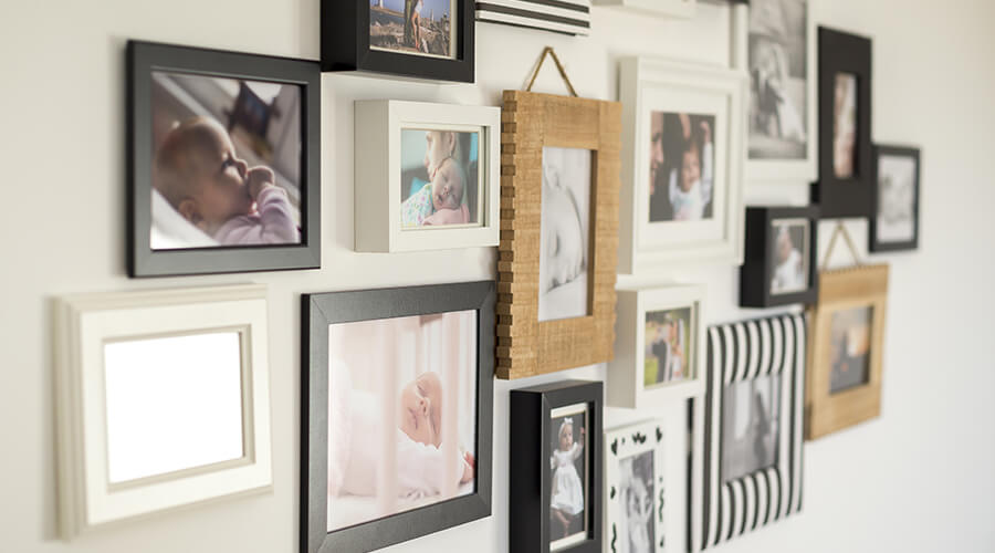 family pictures in frames on wall