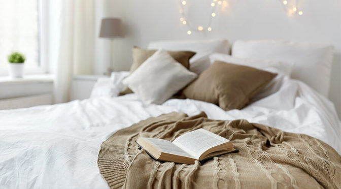 comfy bed with book