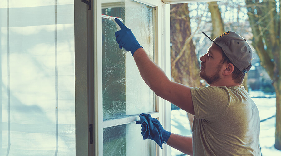 professional window cleaner cleaning windows