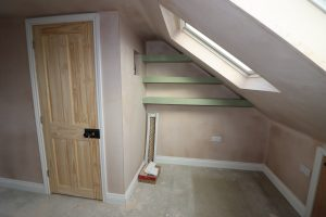 shelves installed on mann dormer loft conversion min scaled